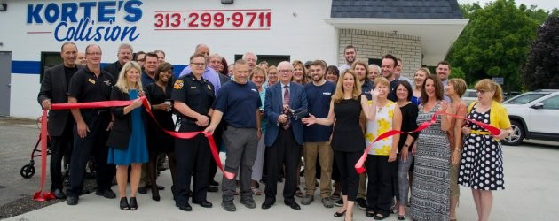 Ribbon cutting for business expansion in TIFA District